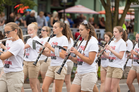 Frankenmuth, Michigan, USA - June 10, 2018 Members of the Frankenmuth High School Band perform at the Bavarian Festival Parade.