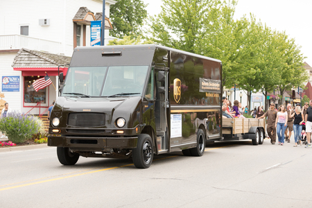 Frankenmuth, Michigan, USA - June 10, 2018 UPS Trucks going down the road at the Bavarian Festival Parade.