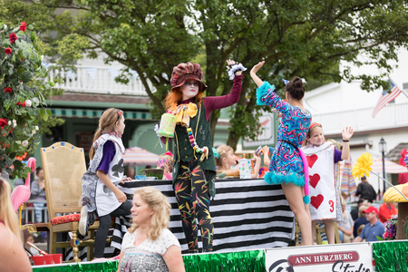 Frankenmuth, Michigan, USA - June 10, 2018 Members of the Ann Herzberg Dance Studio dress up as characters of Alice in Wonderland at the Bavarian Festival Parade. 報道画像