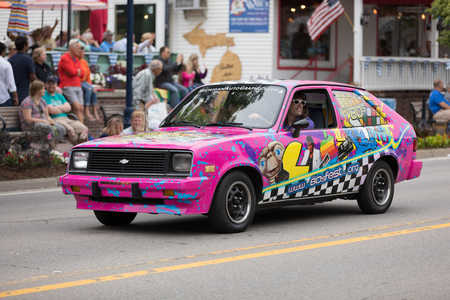 Frankenmuth, Michigan, USA - June 10, 2018 Car promoting 80s fest with a sign that says bringing back the 80s going down the road at the Bavarian Festival Parade. 報道画像