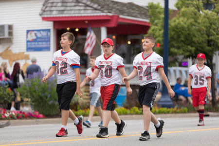 Frankenmuth, Michigan, USA - June 10, 2018 Members of the Muth Youth Football and Cheer going down the road at the Bavarian Festival Parade. Editöryel