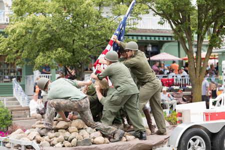 Frankenmuth, Michigan, USA - June 10, 2018 Men and a woman dress up as world war two service men reenact the iwo jima flag raise at the Bavarian Festival Parade. Editorial