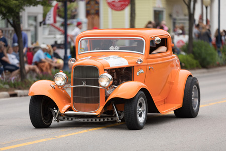 Frankenmuth, Michigan, USA - June 10, 2018 A Hot Rod painted orange with a sticker that says Crush going down the road at the Bavarian Festival Parade. Editöryel