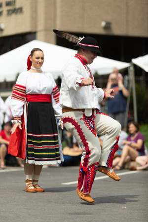 Whiting, Indiana, USA - July 28, 2018 Men and women wearing traditional slovak clothing perform traditional slovak dances at the Pierogi Fest Stock Photo - 107046525