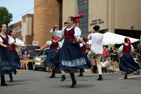 Whiting, Indiana, USA - July 28, 2018 Men and women wearing traditional slovak clothing perform traditional slovak dances at the Pierogi Fest Stock Photo - 107046565