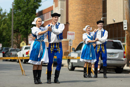 Whiting, Indiana, USA - July 28, 2018 Men and women wearing traditional slovak clothing perform traditional slovak dances at the Pierogi Fest Stock Photo - 107046661