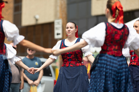 Whiting, Indiana, USA - July 28, 2018 Men and women wearing traditional slovak clothing perform traditional slovak dances at the Pierogi Fest Stock Photo - 107046671