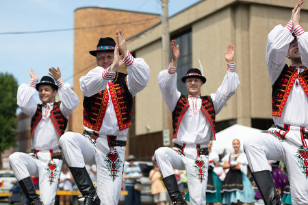 Whiting, Indiana, USA - July 28, 2018 Men and women wearing traditional slovak clothing perform traditional slovak dances at the Pierogi Fest Stock Photo - 107046696