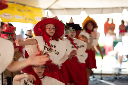 Whiting, Indiana, USA - July 28, 2018 Young women singing and dancing about pierogis at the Pierogi Fest