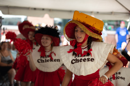 Whiting, Indiana, USA - July 28, 2018 Young women singing and dancing about pierogis at the Pierogi Fest Stock Photo - 107046745