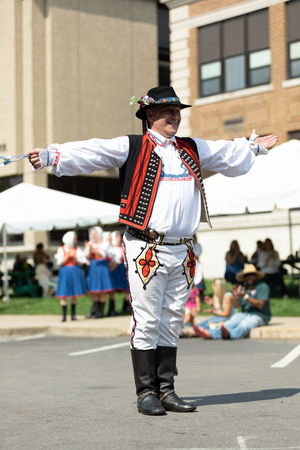 Whiting, Indiana, USA - July 28, 2018 Men  wearing traditional slovak clothing perform traditional Slovakian spoon dance at the Pierogi Fest