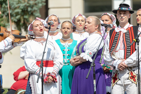 Whiting, Indiana, USA - July 28, 2018 A groupe of Men and women wearing traditional slovak clothing singing slovak traditional songs at the Pierogi Fest