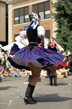 Whiting, Indiana, USA - July 28, 2018 Men and women wearing traditional slovak clothing perform traditional slovak the bottle dance at the Pierogi Fest