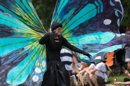 Cleveland, Ohio, USA - June 9, 2018 woman dress up as a butterfly at the abstract art festival Parade The Circle