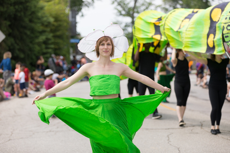 Cleveland, Ohio, USA - June 9, 2018 woman dress up as a flower dancing At the abstract art festival Parade The Circle