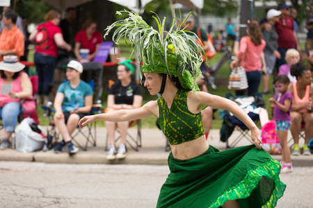 Cleveland, Ohio, USA - June 9, 2018 Woman wearing colorful like a plant At the abstract art festival Parade The Circle Editorial
