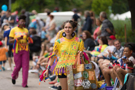 Cleveland, Ohio, USA - June 9, 2018 Woman wearing colorful outfit with face paint At the abstract art festival Parade The Circle
