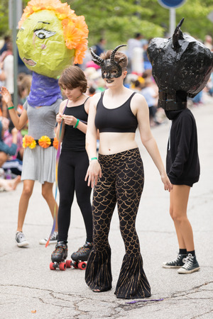 Cleveland, Ohio, USA - June 9, 2018 young woman wearing a face mask with horns At the abstract art festival Parade The Circle Redactioneel