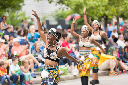Cleveland, Ohio, USA - June 9, 2018 women perform an african dance At the abstract art festival Parade The Circle Redactioneel