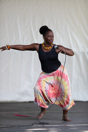 St. Louis, Missouri, USA - August 26, 2018: The Festival of Nations, Men women and children from the Kummba youth Performance Ensemble, perform traditional African American and Afro Caribbean dances.