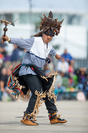 Milwaukee, Wisconsin, USA - September 8, 2018 The Indian Summer Festival, Man wearing traditional native american clothing, dancing at the pow wow competition. 報道画像