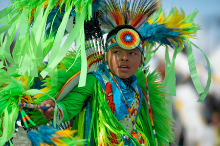 Milwaukee, Wisconsin, USA - September 8, 2018 The Indian Summer Festival, Child wearing traditional native american clothing, dancing at the pow wow competition.