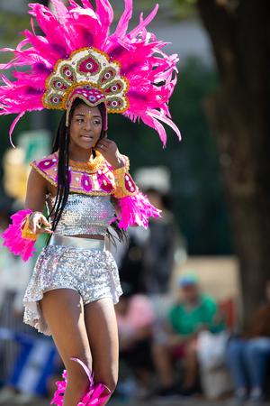 Washington, D.C., USA - September 29, 2018: The Fiesta DC Parade, Woman wearing traditional Panamanian clothing dancing 報道画像