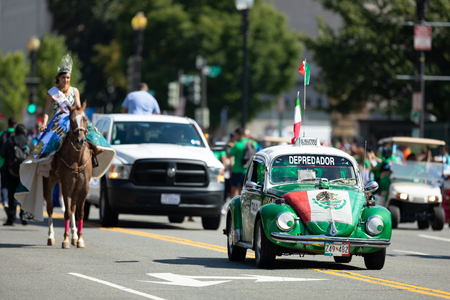 Washington, D.C., USA - September 29, 2018: The Fiesta DC Parade, Volkswagen Beetle Taxi, carrying the mexican flag