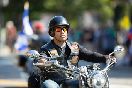 Washington, D.C., USA - September 29, 2018: The Fiesta DC Parade, Man from el Puerto Rico riding a motorcycle Members of the latin american motorcycle association 新聞圖片