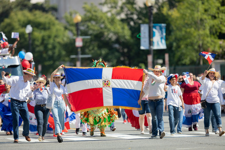 Washington, D.C., USA - September 29, 2018: The Fiesta DC Parade, People carry the flag of the Dominican Republic