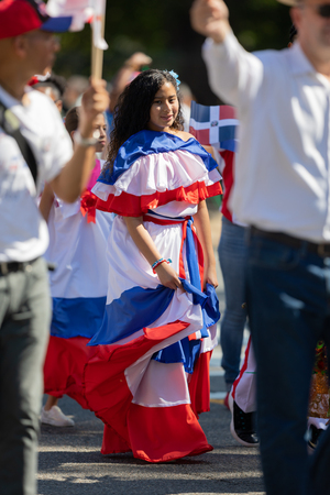 Washington, D.C., USA - September 29, 2018: The Fiesta DC Parade, Woman wearing traditional clothing from the Dominican Republic 報道画像