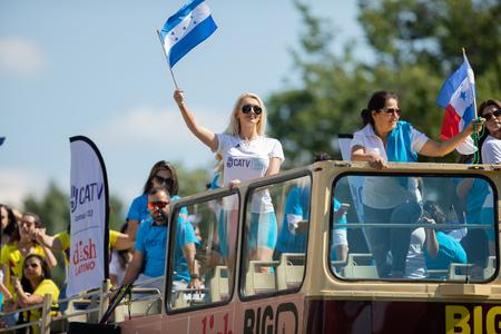 Washington, D.C., USA - September 29, 2018: The Fiesta DC Parade, Woman waving the flag from Honduras 報道画像