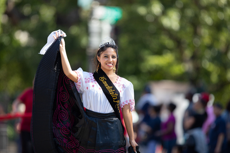 Washington, D.C., USA - September 29, 2018: The Fiesta DC Parade, Peruvian woman beauty queen wearing traditional clothing