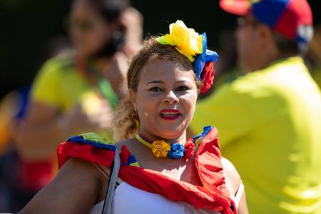 Washington, D.C., USA - September 29, 2018: The Fiesta DC Parade, Colombian woman wearing traditional colombian clothing dancing