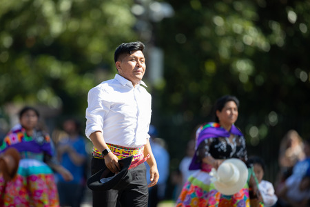 Washington, D.C., USA - September 29, 2018: The Fiesta DC Parade, Peruvian man wearing traditional clothing danicng during the parade Foto de archivo - 116662994
