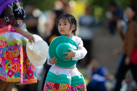 Washington, D.C., USA - September 29, 2018: The Fiesta DC Parade, Child wearing traditional peruvian clothing dancing Editorial