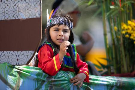 Washington, D.C., USA - September 29, 2018: The Fiesta DC Parade, Child wearing traditional peruvian clothing on a float Foto de archivo - 116662999