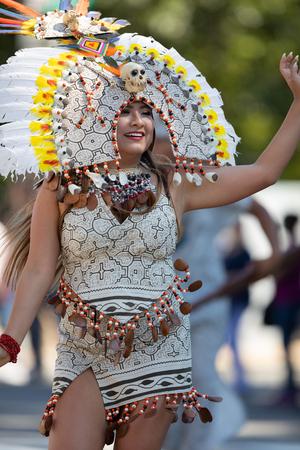 Washington, D.C., USA - September 29, 2018: The Fiesta DC Parade, peruvian woman wearing traditional clothing danicng during the parade