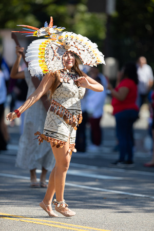 Washington, D.C., USA - September 29, 2018: The Fiesta DC Parade, peruvian woman wearing traditional clothing danicng during the parade Foto de archivo - 116663005