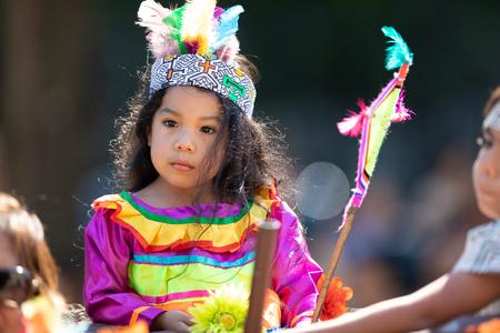 Washington, D.C., USA - September 29, 2018: The Fiesta DC Parade, peruvian child wearing traditional clothing on a float Foto de archivo - 116663015