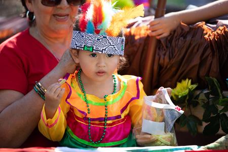 Washington, D.C., USA - September 29, 2018: The Fiesta DC Parade, peruvian child wearing traditional clothing on a float Foto de archivo - 116663016