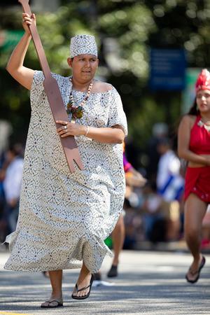 Washington, D.C., USA - September 29, 2018: The Fiesta DC Parade, peruvian man wearing traditional clothing danicng during the parade