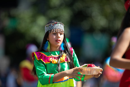 Washington, D.C., USA - September 29, 2018: The Fiesta DC Parade, peruvian girl wearing traditional clothing danicng during the parade Editorial
