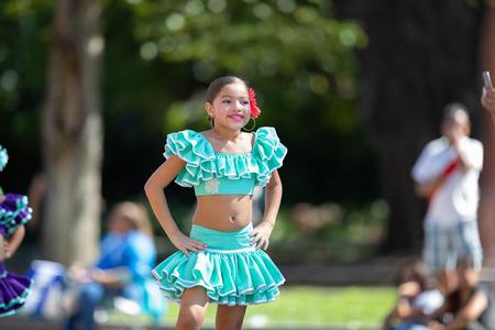 Washington, D.C., USA - September 29, 2018: The Fiesta DC Parade, peruvian girl wearing traditional clothing danicng during the parade Foto de archivo - 116663033