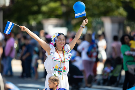 Washington, D.C., USA - September 29, 2018: The Fiesta DC Parade, Woman wearing traditional clothing from Nicaragua dancing