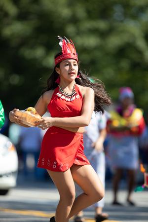 Washington, D.C., USA - September 29, 2018: The Fiesta DC Parade, peruvian woman wearing traditional clothing danicng during the parade Foto de archivo - 116747162