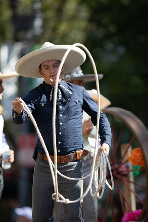 Washington, D.C., USA - September 29, 2018: The Fiesta DC Parade, Mexican man dress up as a charro handling a lasso 写真素材 - 116748810