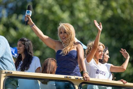 Washington, D.C., USA - September 29, 2018: The Fiesta DC Parade, Women Promoting CATV and waving latin american national flags 報道画像
