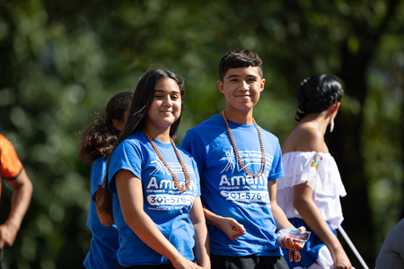 Washington, D.C., USA - September 29, 2018: The Fiesta DC Parade, Young man and woman from el Salvador smile for the camera during the parade