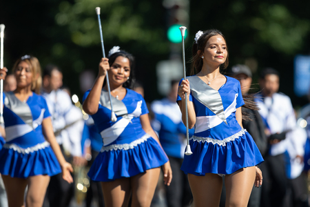 Washington, D.C., USA - September 29, 2018: The Fiesta DC Parade, Cheerleaders from the Angeles de Paz from el salvador, dancing at the parade